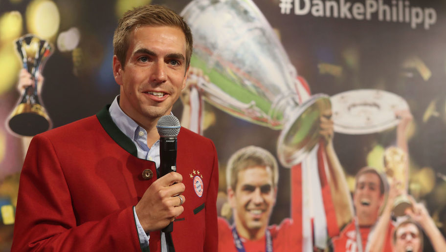 Philipp Lahm Hands Over Championship Trophy To FCB Erlebniswelt